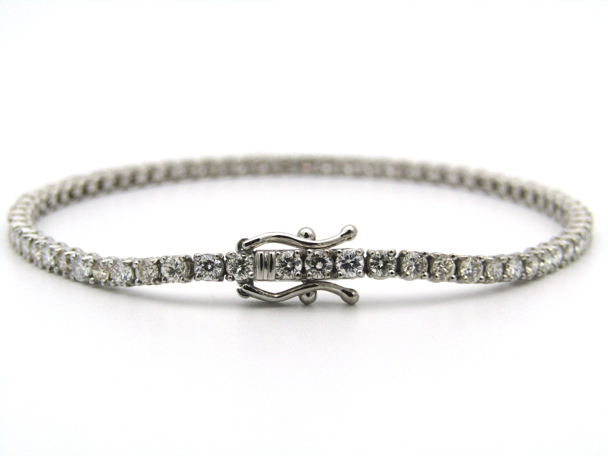 18K gold diamond tennis bracelet.