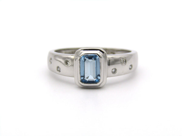 9K gold blue topaz and diamond ring by Browns.