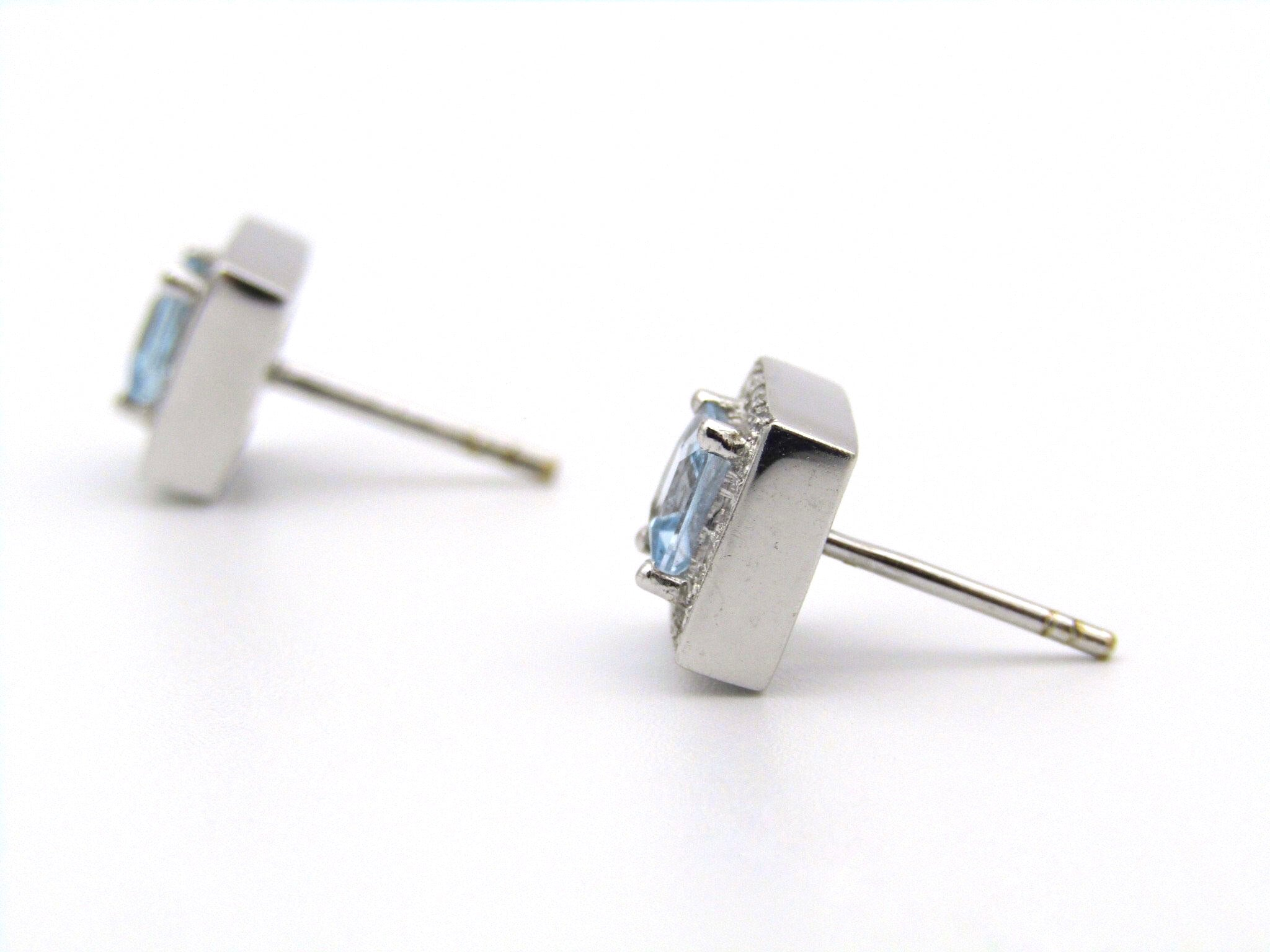 A pair of 18kt gold Blue Topaz and diamond earrings.