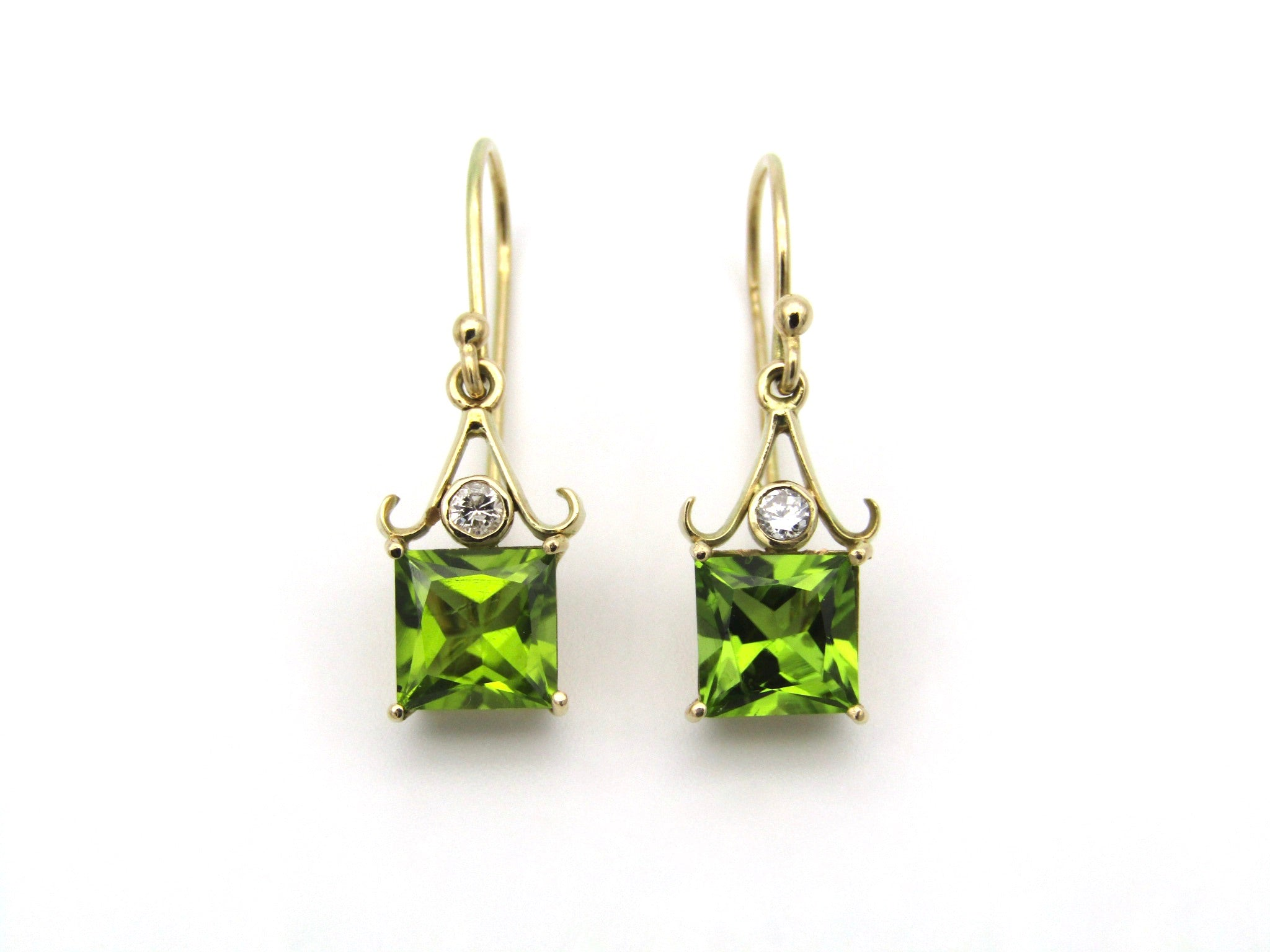 9K gold peridot and diamond earrings.
