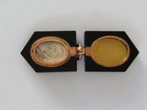 A 9kt gold Victorian black onyx pendant and locket