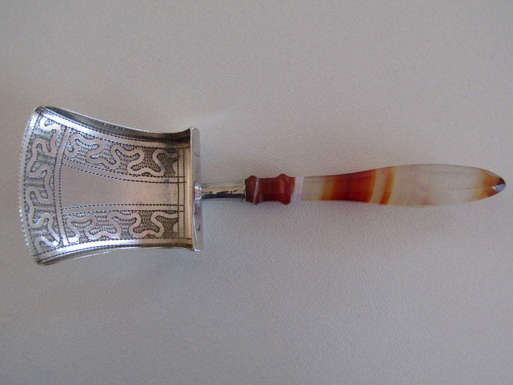 A Georgian silver caddy spoon with an agate handle