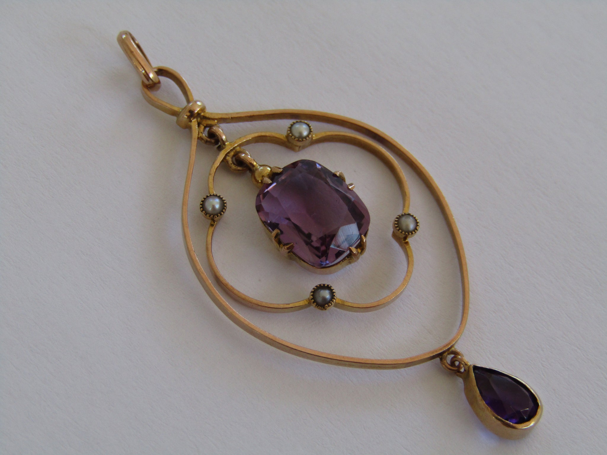 A 9kt gold Edwardian amethyst and seed pearl pendant