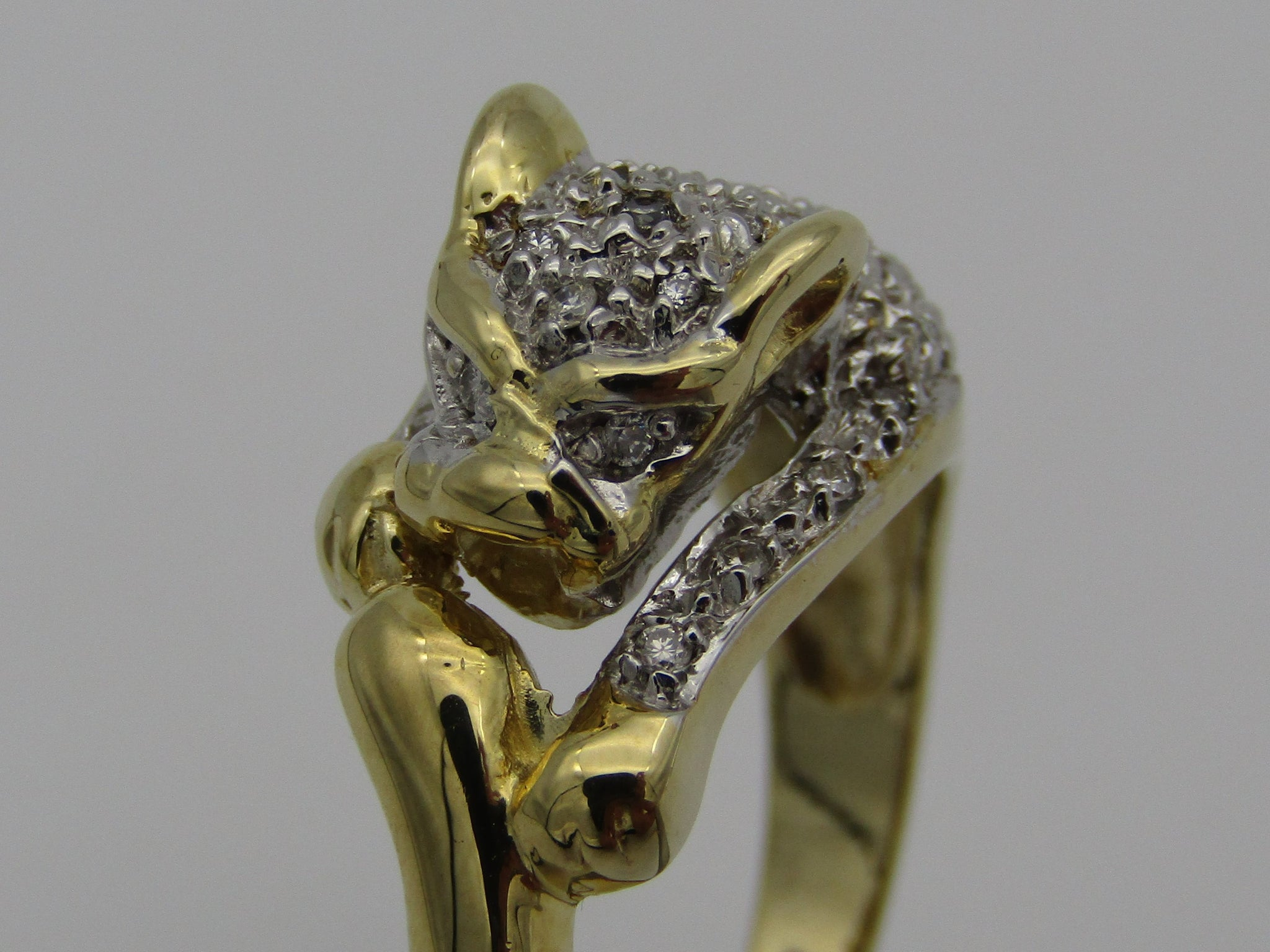 9kt gold Cartier style diamond ring.