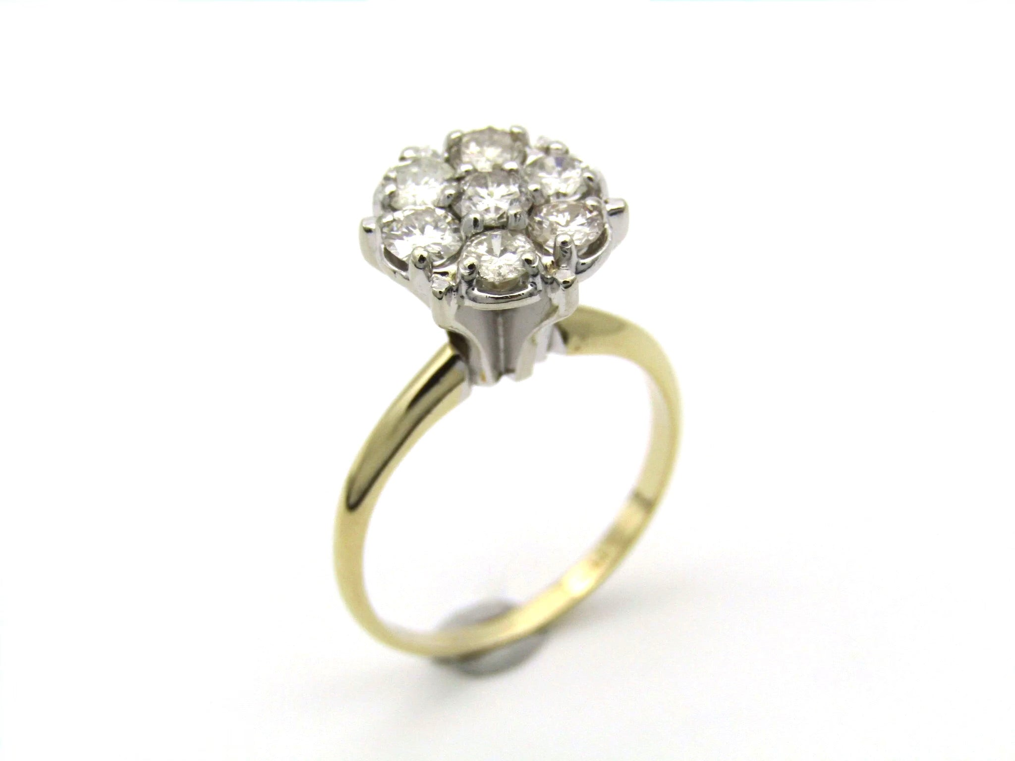A Vintage 14K gold diamond cluster ring.