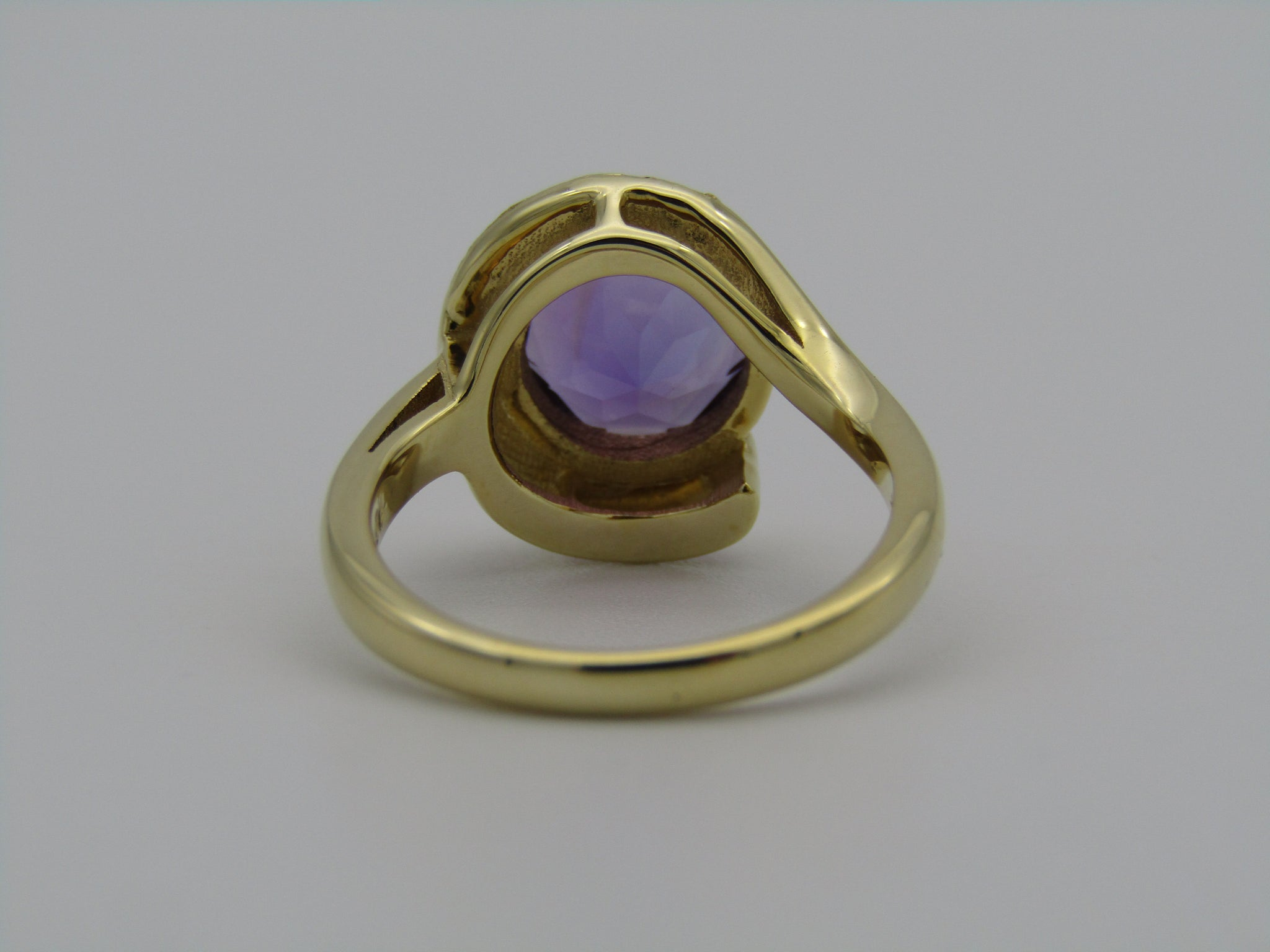 18kt gold amethyst and diamond ring.