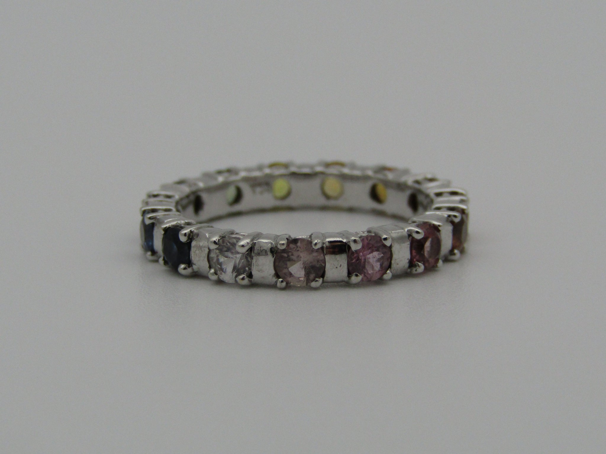 18kt gold multi-coloured sapphire tennis ring.