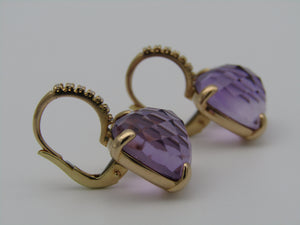 Pair of 18kt gold amethyst and diamond earrings.