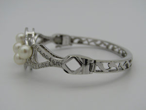14kt white gold diamond and pearl catch bangle.