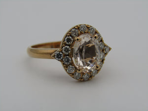 14kt gold colourless sapphire and diamond ring.