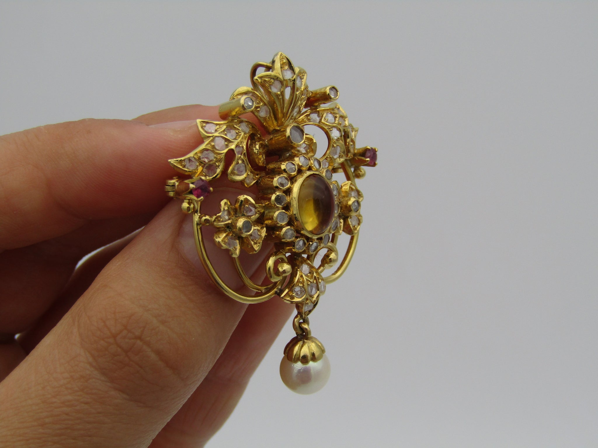 18kt yellow gold Victorian diamond, ruby, citrine and pearl pendant/brooch.