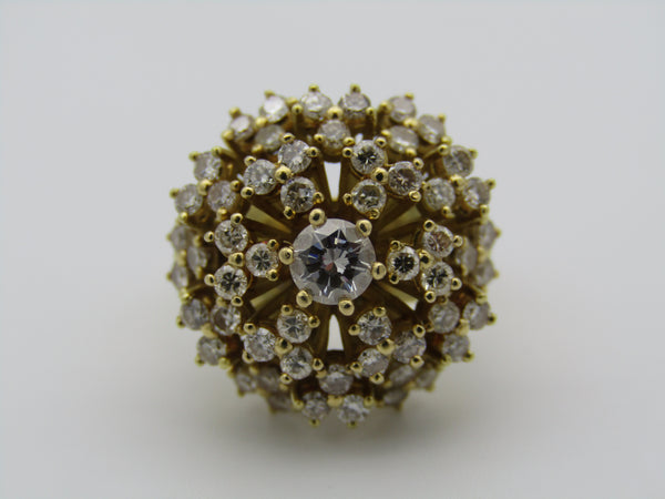 18kt yellow gold diamond cluster ring.