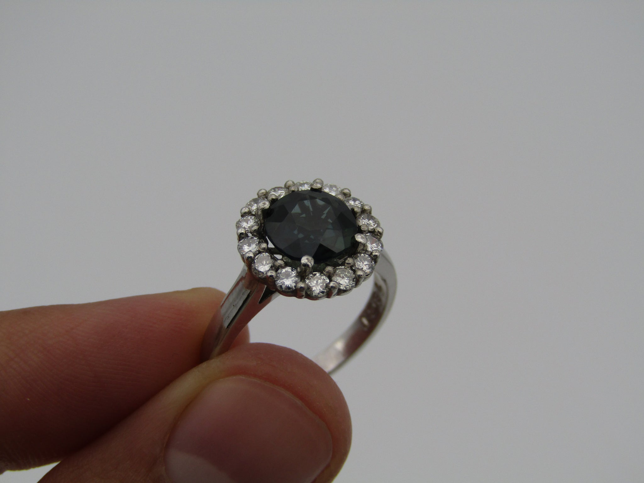 18kt white gold sapphire and diamond ring.
