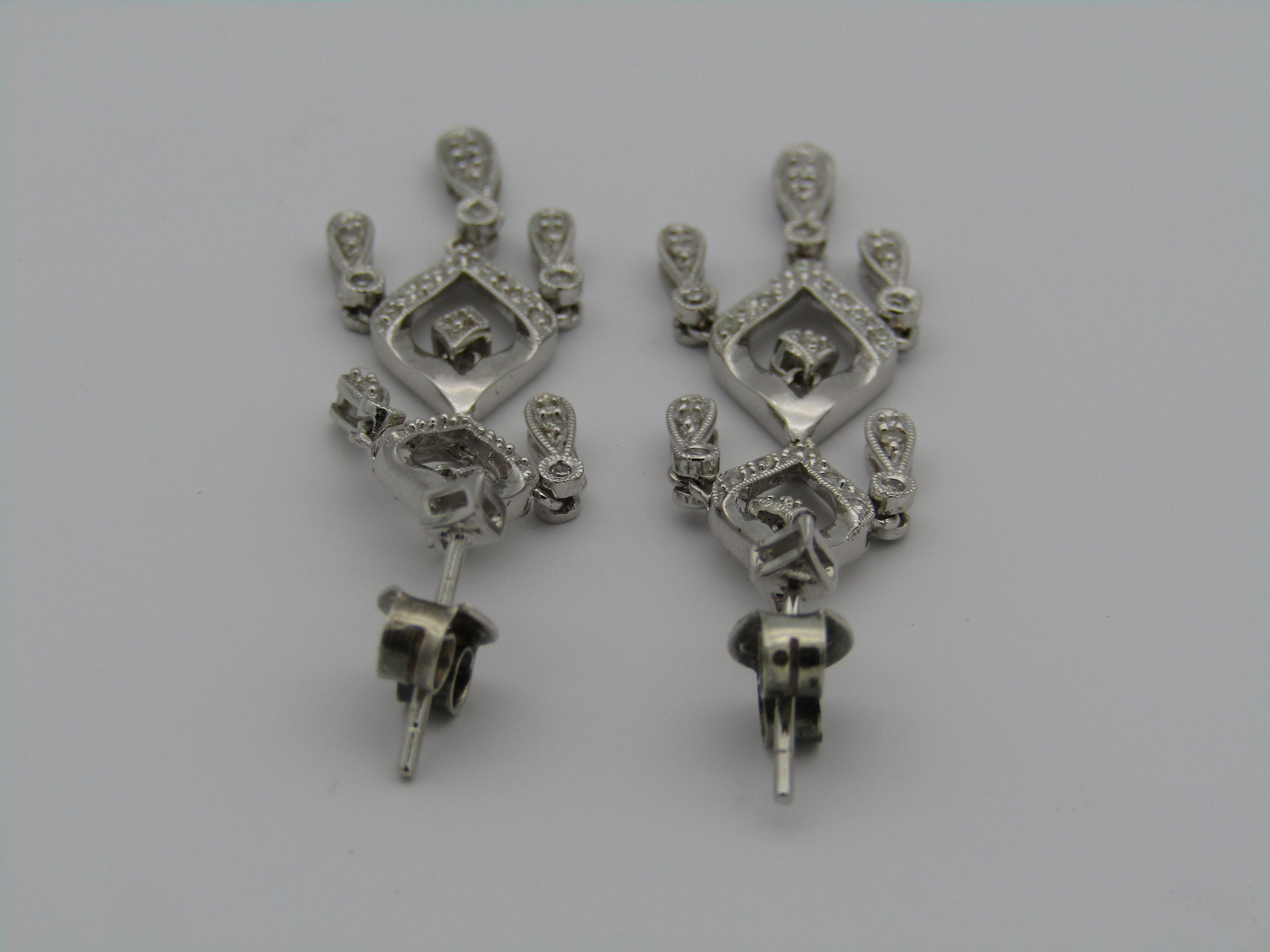 14kt white gold chandelier diamond earrings.