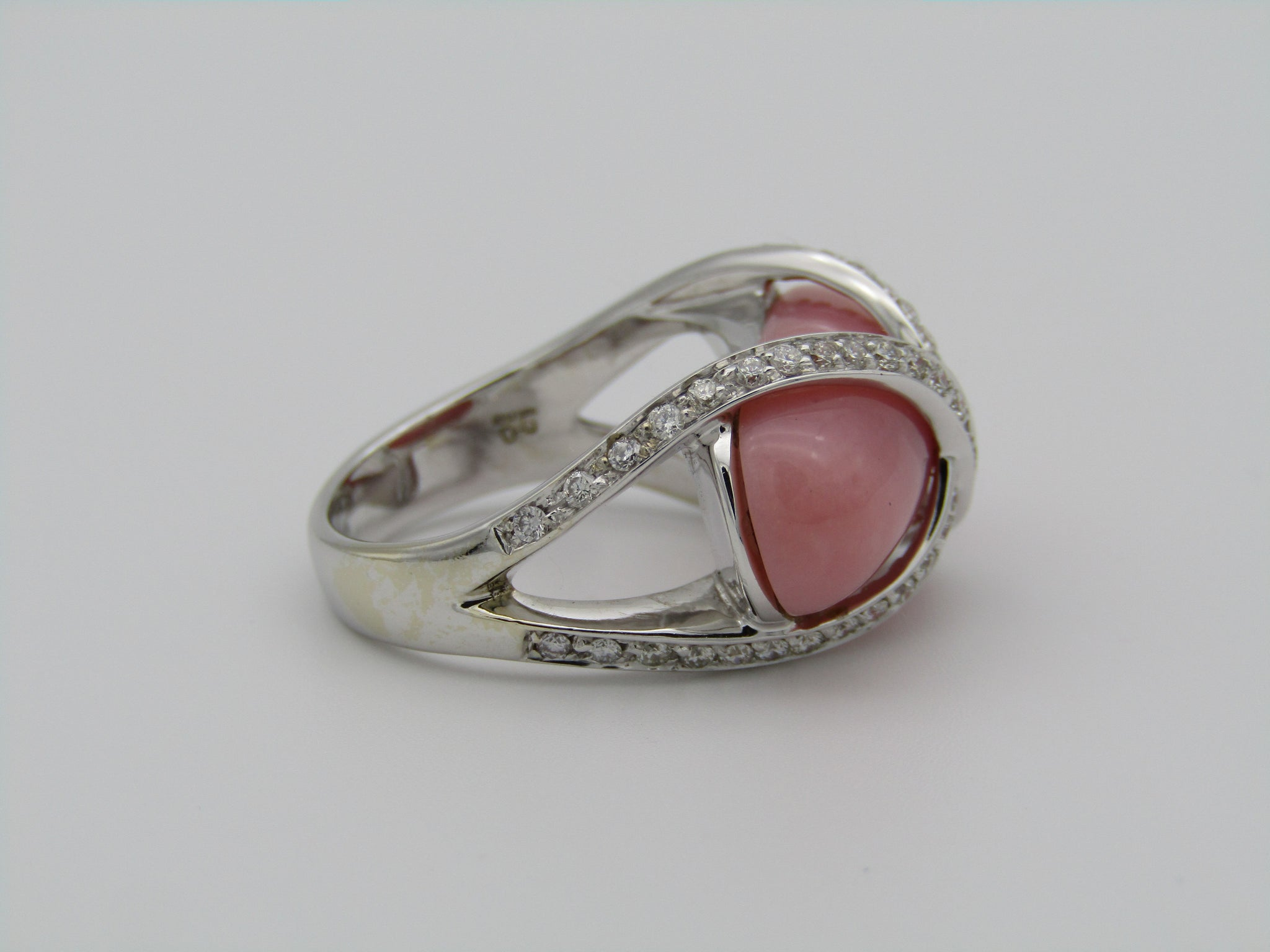 18kt white gold pink opal and diamond ring.