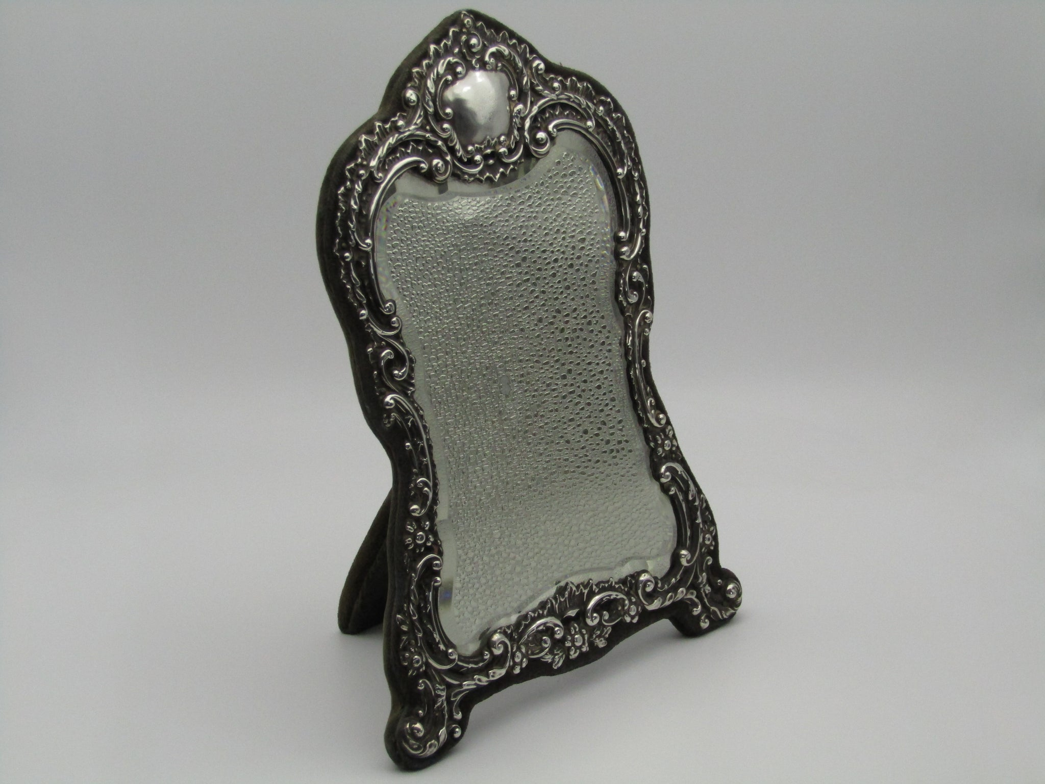 Silver mirror by H. Matthews, made in Birmingham, England, in the year 1902.