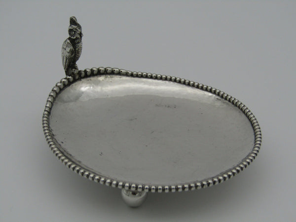 Silver card tray with a cockatoo on the rim. The silver is stamped 830.