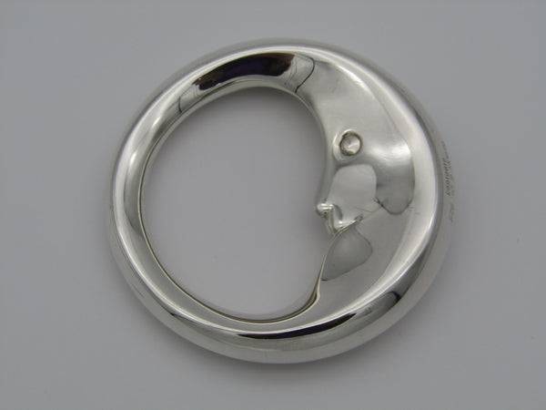 "Tiffany & Co. sterling silver ""Man in the moon"" baby rattle. With the name ""Luke"" engraved on the rim."