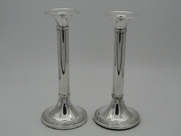 "Pair of South African sterling silver candlesticks, made in 1994, with maker's mark ""MSC""."