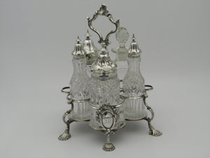 Georgian silver Warwick Cruet with silver mounted cut-crystal condiment bottles (bottles are Victirian and are later), by John Deacon. Made in London, England, in 1768.