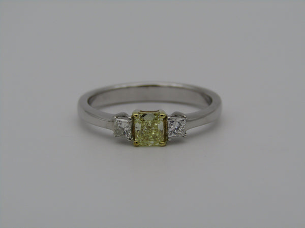 A platinum and 18kt gold fancy yellow diamond ring by Browns.