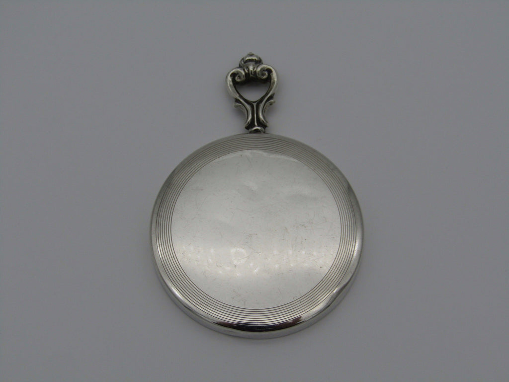 A sterling silver hand mirror by Cartier. Circa 1920s.