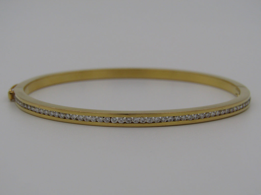 20ct gold diamond bangle.