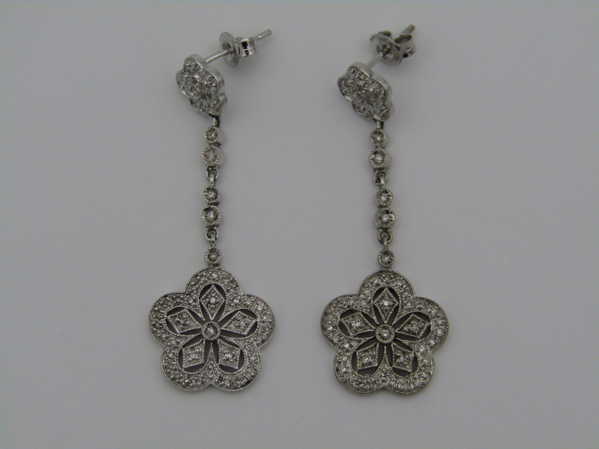 A pair of 9kt gold diamond earrings.