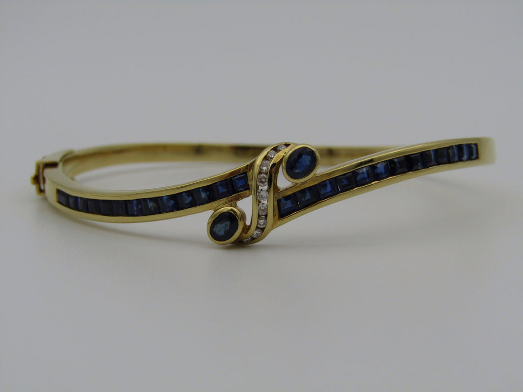 18kt gold sapphire and diamond bangle.