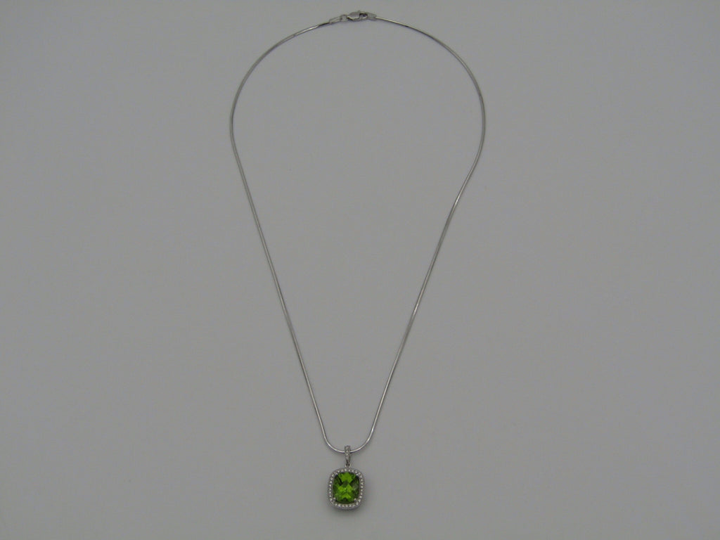 14K white gold peridot and diamonds pendant by Browns.
