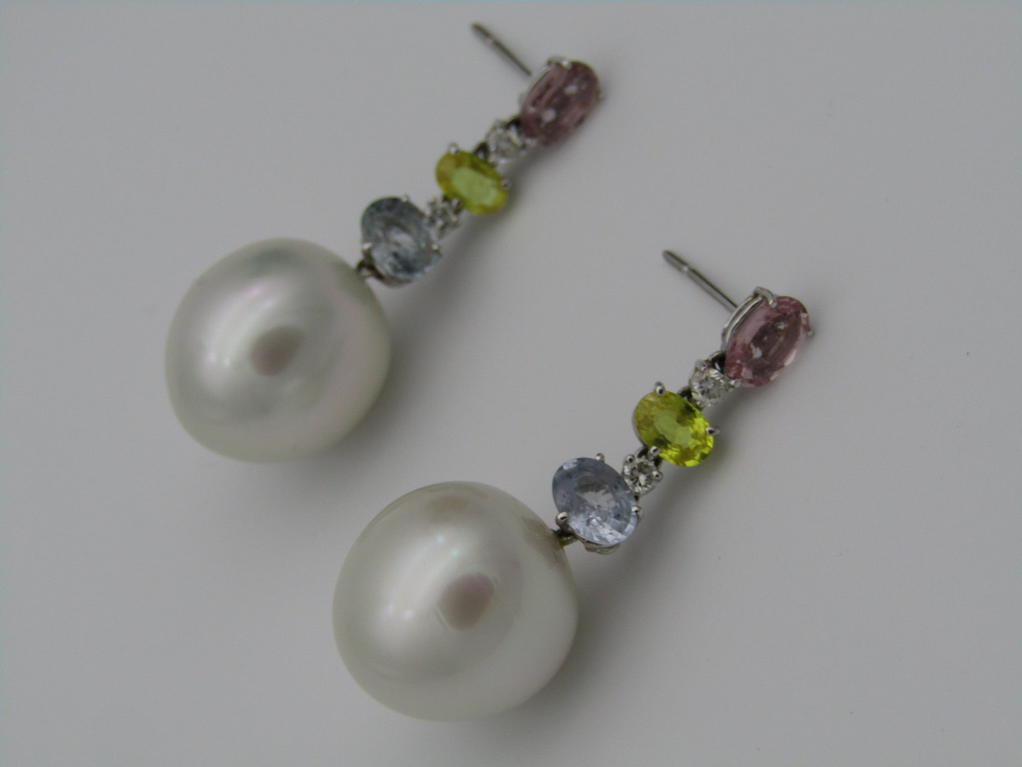 Pair of 18kt white gold South Sea Pearls, sapphires, and diamonds earrings by La Putri.