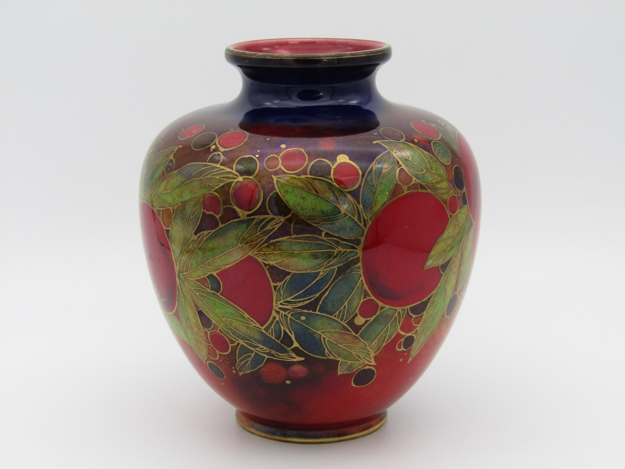 Royal Doulton Flambe Pomegranate bulbous vase with gilt highlights by Harry Nixon.