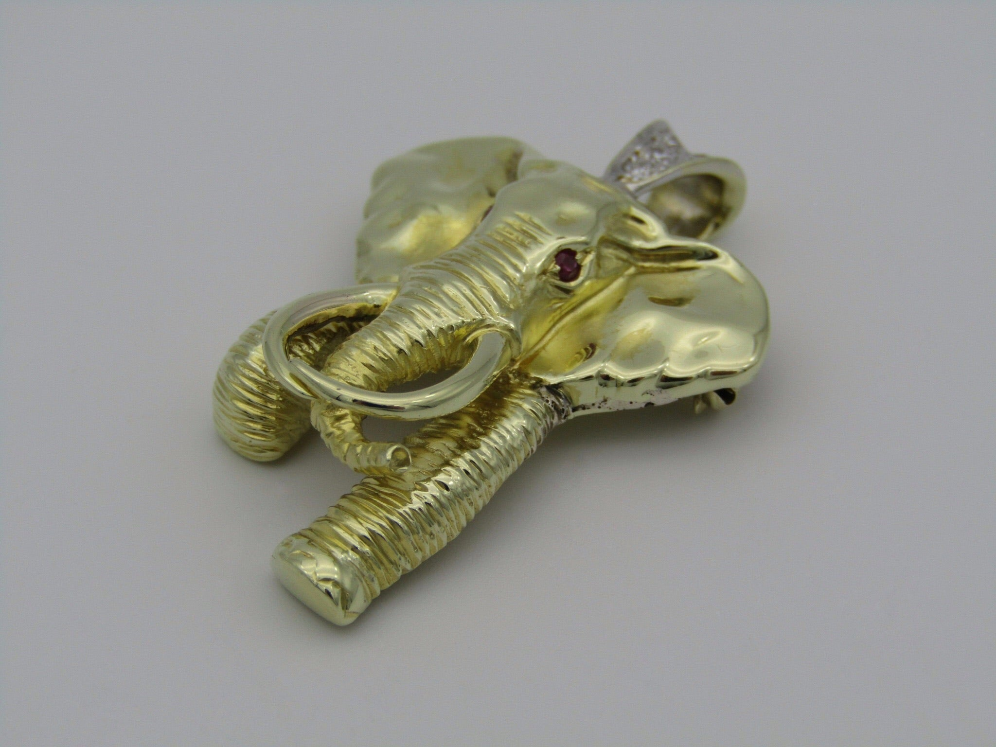 14kt gold diamond Elephant pendant and brooch.