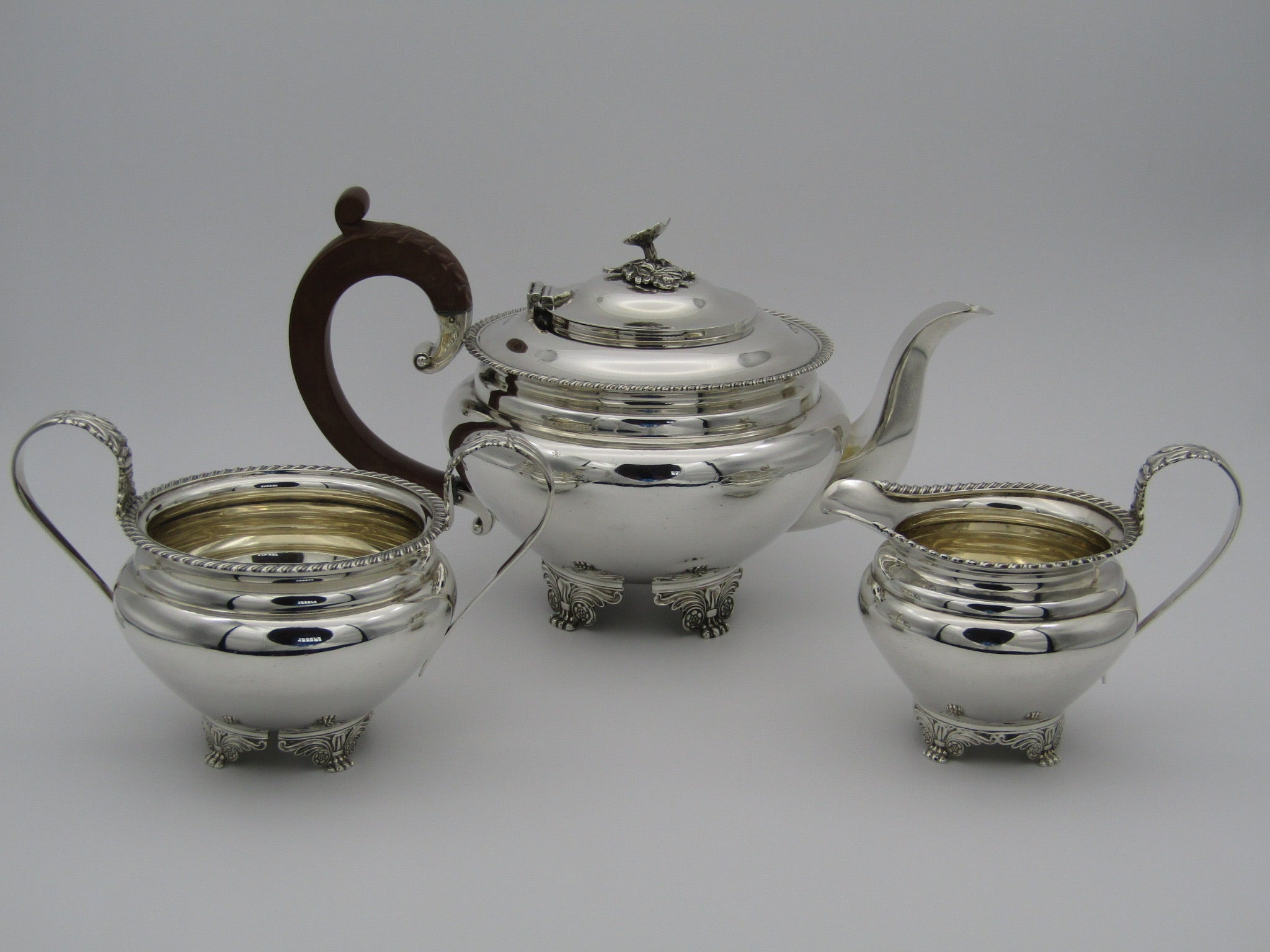 A three piece silver tea set by Mappin & Webb, Birmingham, 1968.