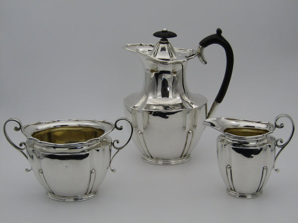 A three piece sterling silver coffee set by Roberts & Belk, Sheffield, 1902.