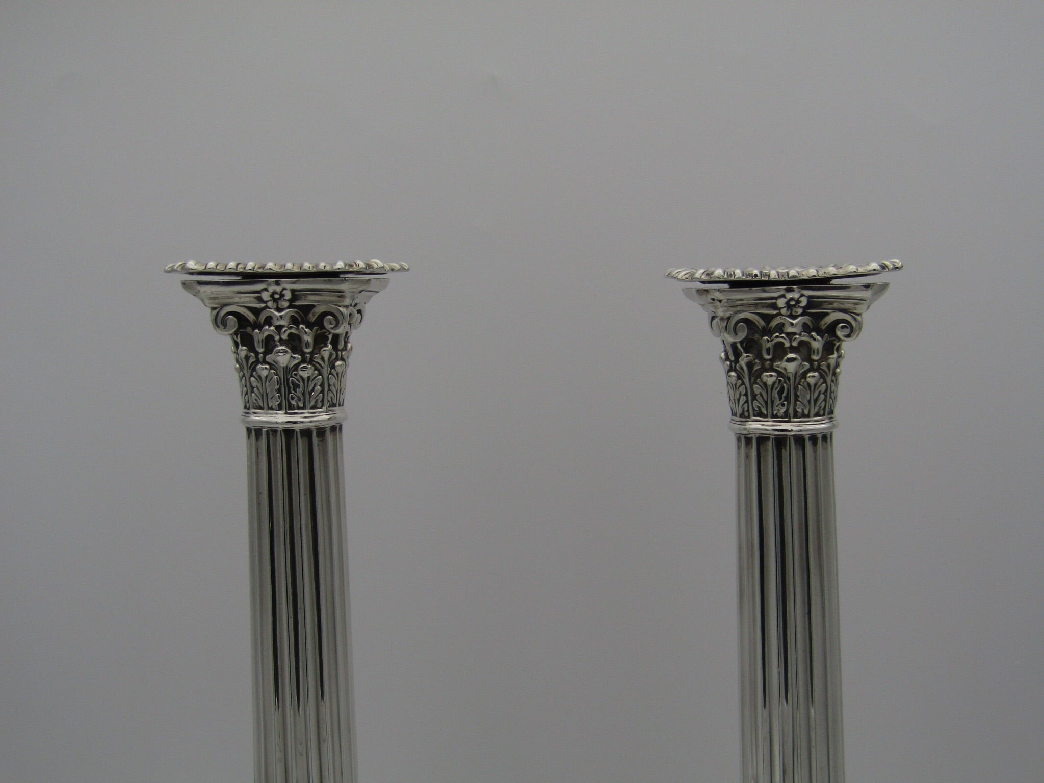 Pair of Corinthian style silver candlesticks by Hawksworth Eyre & Co Ltd. Made in Sheffield 1905.
