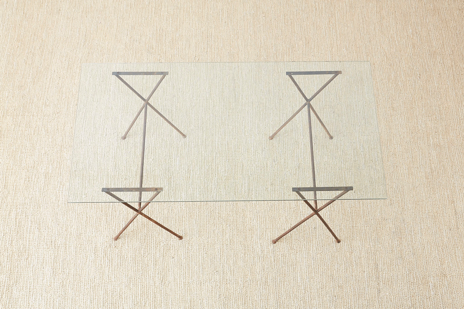 Midcentury Glass Table with Iron X Form Sawhorse Legs