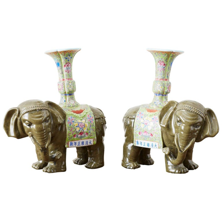 Pair of Chinese Jade Colored Porcelain Elephant Candlesticks