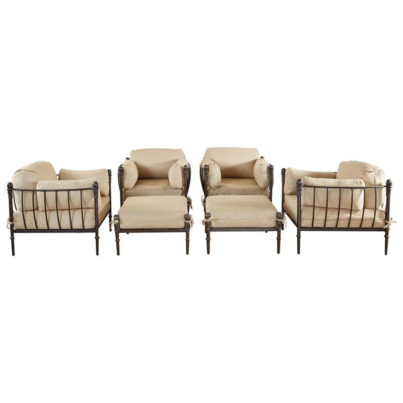 Set of Four Michael Taylor Bronzed Lounge Chairs with Ottomans