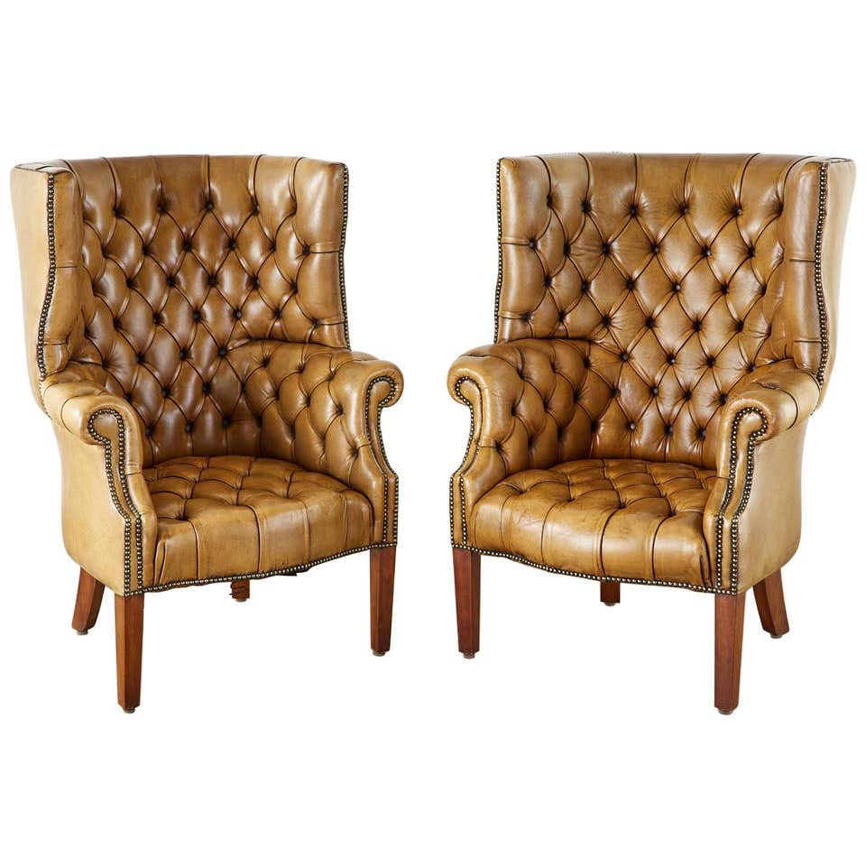 Pair of English Georgian Cigar Leather Porters Wingback Chairs