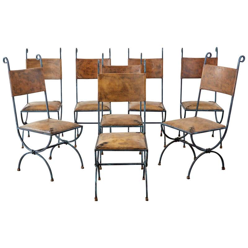 Eight Llana Goor Style Curule Leg Iron Leather Dining Chairs