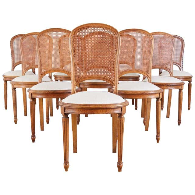 Set of 10 French Louis XVI Style Walnut Caned Dining Chairs
