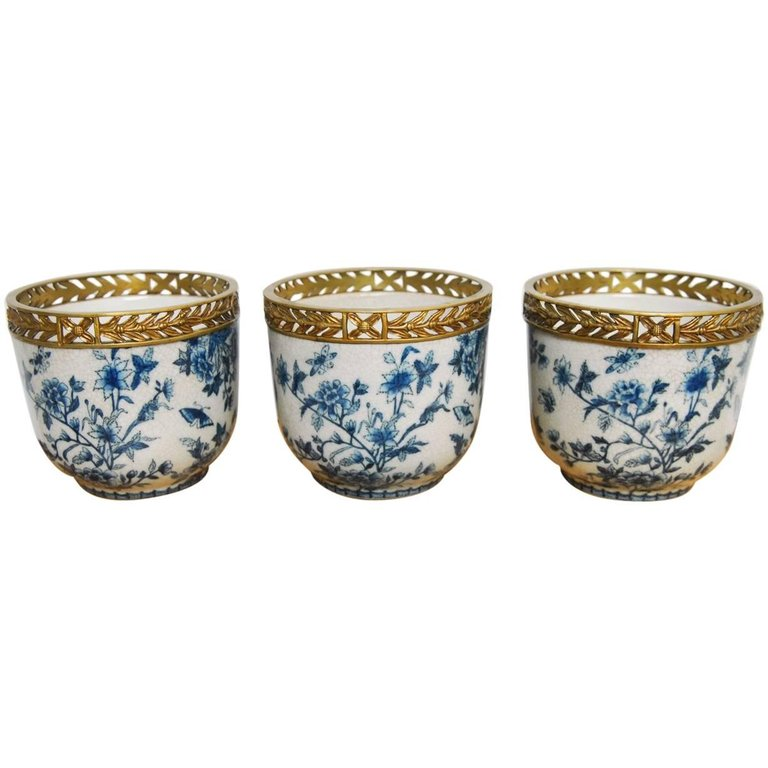 Set of Three Chinese Brass Mounted Blue and White Porcelain Urns