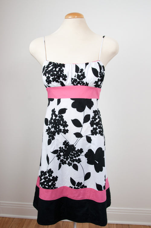 Black, white and pink garden party dress by Caravan clothes at Caravan clothes