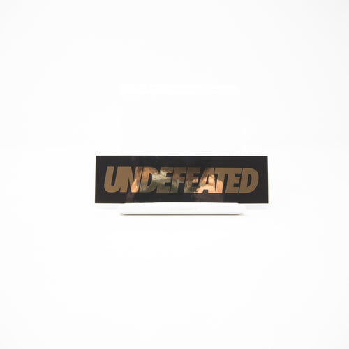 Undefeated Gold Text Sticker (MINT)