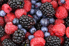A pile of blueberries, rasberries, and blackberries | Bubu Brands