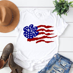 A distressed american paw shirt on a bright background with blue jeans brown boots and a brown hat | Bubu Brands