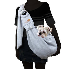 A light dog in a sling on the back of a human wearing dark clothing | Bubu Brands