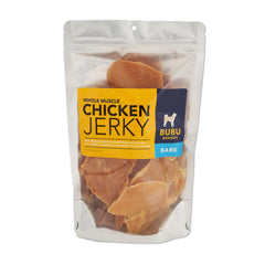 A bright colored bag of dog jerky that says whole muscle chicken jerky by Bubu Brands | Bubu Brands