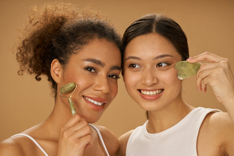 two-girls-smiling-using-gua-sha-and-a-jade-roller